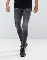 Asos Extreme Super Skinny Jeans In Washed Blaxk With Rips And Hem Detail Washed Black