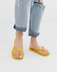 Havaianas Slim Flip Flops In Bright Yellow