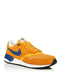 Nike Air Odyssey Lace Up Sneakers Gold