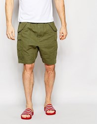 Asos Slim Shorts With Cargo Styling In Khaki Khaki Green
