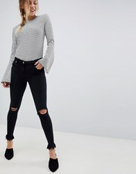 Parisian Skinny Jeans With Knee Rips And Raw Hem Black