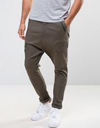 Asos Drop Crotch Cargo Trousers With Zip Details In Khaki Forest Night Green