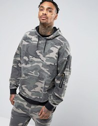 Asos Oversized Hoodie In Washed Camo Print Camo Green