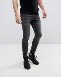 Asos Extreme Super Skinny Jeans With Bleach Paint Splatter In Washed Black Washed Black