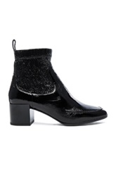 Pierre Hardy Patent Leather Ace Booties In Black