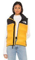 The North Face 1996 Retro Nuptse Vest In Yellow. Tnf Yellow