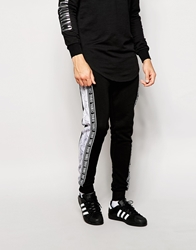 Criminal Damage Joggers With Marble And Side Taping Black