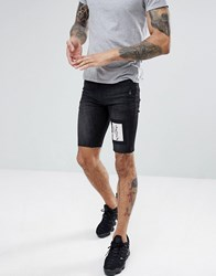 Religion Skinny Fit Denim Shorts In Washed Black With Skeleton Patch