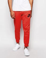 Nike Aw77 Skinny Joggers In Red 727369 672 Red