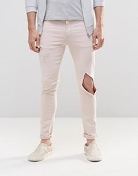 Asos Super Skinny Jeans With Open Rips In Light Pink Light Pink
