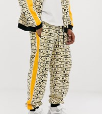 Heart And Dagger Repeat Logo Print Zip Up Jogger Yellow