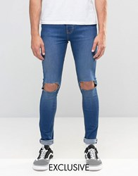 Reclaimed Vintage Washed Super Skinny Jeans With Knee Rips Indigo Washed Blue