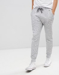 Hollister Icon Logo Fleece Cuffed Jogger In White Black Printed Texture White Black Printed