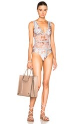 Zimmermann Pavilion Ladder Swimsuit In Blue Floral