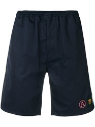Alexander Mcqueen Embroidered Badge Shorts Blue