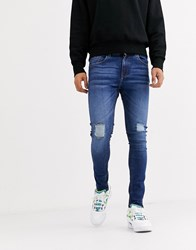 Criminal Damage Skinny Jeans In Midwash Blue With Distressing
