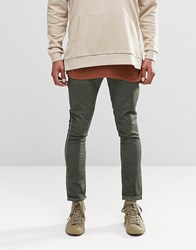 Asos Super Skinny Chinos With Oil Wash In Green Rosin
