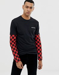 Your Turn Yourturn Long Sleeve Top In Black With Red Checkerboard Sleeves