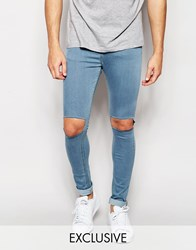 Reclaimed Vintage Super Skinny Jeans With Knee Rips Blue
