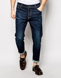 Asos Stretch Tapered Jeans In Dark Wash Blue