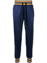 Dolce And Gabbana Logo Print Trousers Blue