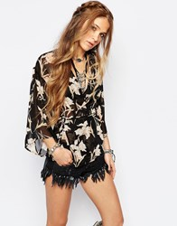 Honey Punch Wrap Front Top In Sheer Floral Black