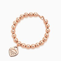 Tiffany And Co. Return To Tiffanytm Small Heart Tag In 18K Rose Gold On A Bead Bracelet Medium.