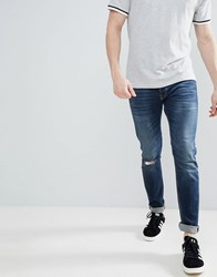 United Colors Of Benetton Slim Fit With Rips In Mid Wash Blue
