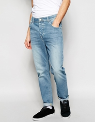 Asos Stretch Tapered Jeans In Light Blue Wash