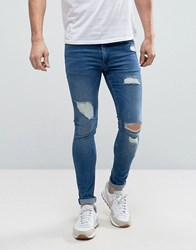 Asos Extreme Super Skinny Jeans With Open Rips In Mid Blue Blue