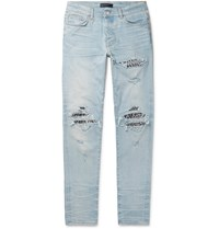 Amiri Mx1 Skinny Fit Panelled Distressed Stretch Denim Jeans Blue