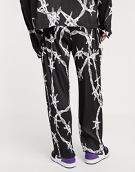Jaded London Plisse Trousers With Barbed Wire Print In Black