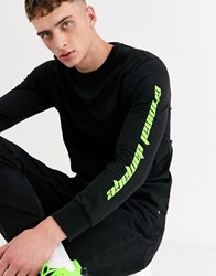 Criminal Damage Long Sleeve T Shirt In Black With Neon Logo