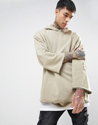 Asos Oversized Hoodie With Raw Edges And Sleeve Pocket In Wash Beige