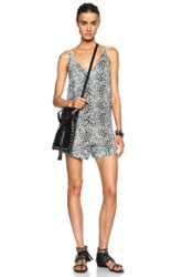 Zimmermann Pivot Dip Viscose Romper In Black White Animal Print