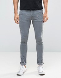 Asos Super Skinny Jeans With Rips And Distressing In Grey Grey