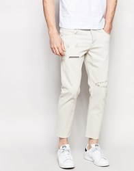 Asos Slim Jeans In Ecru With Raw Hem And Rip And Repair Details Beige
