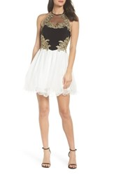 Blondie Nites Applique Bodice Fit And Flare Halter Dress Black Ivory Gold