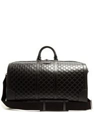 Gucci Gg Debossed Leather Holdall Black