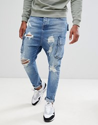 Asos Design Drop Crotch Jeans In Mid Wash Blue With Cargo Pockets And Rips Mid Wash Blue