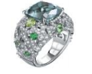 Garrard An 18Ct White Gold Bombe Cocktail Ring From The Tudor Rose Collection Set With A Central Cushion Green Tourmaline Surrounded By Round White Diamonds Tourmalines And Tsavorites.