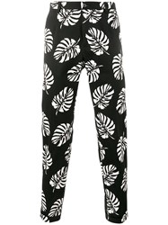 Dolce And Gabbana Palm Leaf Print Trousers Black