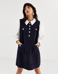 Sister Jane Pinafore Dress With Shirt Layer And Heart Buttons In Cord Navy
