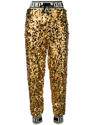 Dolce And Gabbana Logo Sequinned Track Pants Gold