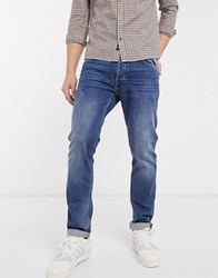 Replay Donny Slim Tapered Fit Jeans In Mid Wash Blue