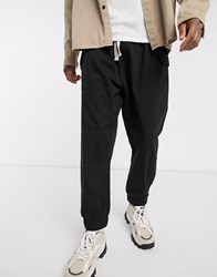 Reclaimed Vintage Inspired Drop Crotch Cargo Trousers With Drawstring In Black