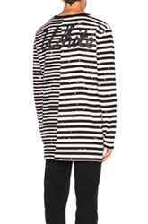 Off White Striped Long Sleeve Tee In Black Stripes Black Stripes