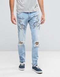 Asos Skinny Jeans With Embroidery In Light Blue Light Blue Black