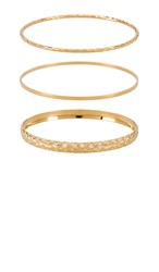 Vanessa Mooney X Revolve The Bold And Finesse Bangle Set In Metallic Gold.