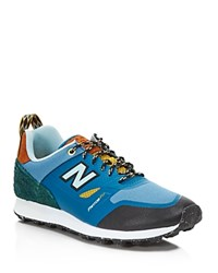 New Balance Trailbuster Re Engineered Sneakers Blue Green Yellow Black